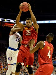 Maryland Terrapins forward Damonte Dodd (35) grabs a rebound against Kansas Jayhawks forward Carlton Bragg Jr. (15) during the first half in a semifinal game in the South regional of the NCAA Tournament at KFC YUM!