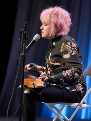 """Cyndi Lauper performs """"Time After TIme"""" at the telethon for """"Dolly Parton's Smoky Mountains Rise: A Benefit for the My People Fund"""" Tuesday, Dec. 13, 2016, in Nashville, Tenn."""