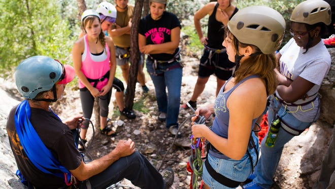 Western New Mexico University students gather for an outdoor class. The university is one of the few institutions in the country offering outdoor behavioral health training.