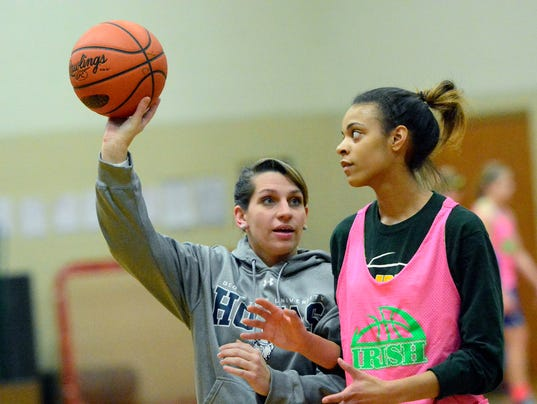 PHOTOS: Father-daugther duo coach York Catholic team