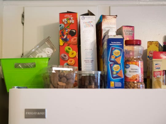 Dried African foods sit atop Timothy Brass' fridge