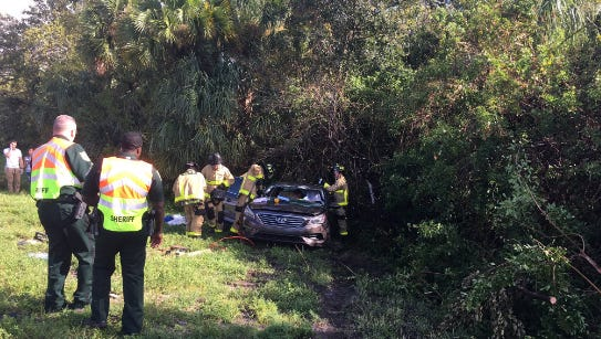 Crews work to extract passengers from a vehicle on I-95 north near exit 191.