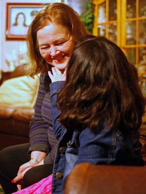 Kellie Lechuga spends time with her 6-year-old granddaughter at her Salem home.