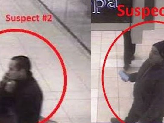 Police are attempting to identify these two suspects for an alleged theft.