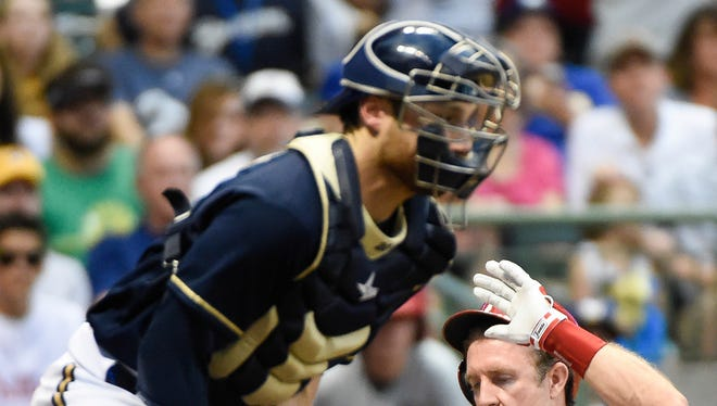 Philadelphia Phillies second baseman Chase Utley (26) scores on a hit by first baseman Ryan Howard (not pictured) as Milwaukee Brewers catcher Jonathan Lucroy (20) fields the ball in the third inning at Miller Park.