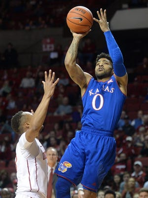Kansas guard Frank Mason III (0) shoots the ball over Oklahoma guard Darrion Strong-Moore (0) during the first half.