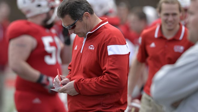 St. John's football coach Gary Fasching takes notes on the sideline during the team's Red and White Spring game on April 30 at Clemens Stadium,