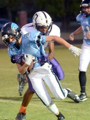 Portland West Middle School's Dairius Bell tackles Ellis running back Logan Spurrier during first-half action. Spurrier rushed for 168 yards and two touchdowns in the 28-24 victory.
