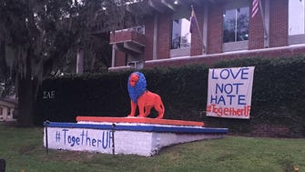 "The Sigma Alpha Epsilon house on the University of Florida campus is one of several fraternities and sororities sporting ""Love not hate #togetherUF"" signs Oct. 17, 2017, ahead of a speech by white nationalist Richard  Spencer."