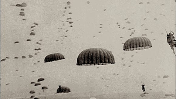 WWII Paratroopers in drop zone (Library of Congress photo)