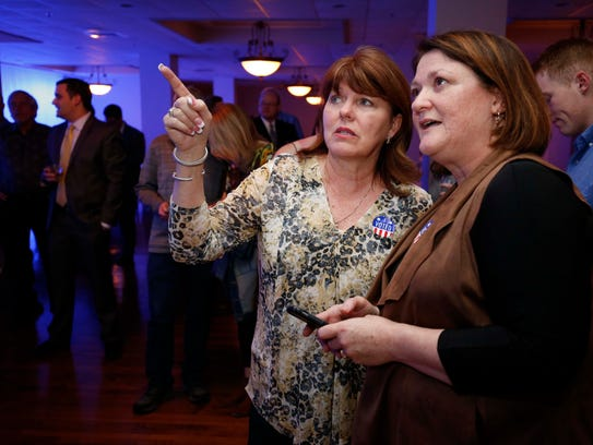 Denise Frederick, left, and Carol Embree look at the