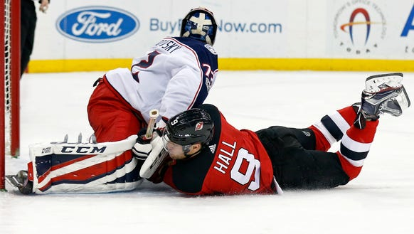 New Jersey Devils left wing Taylor Hall (9) collides