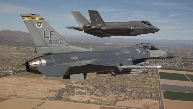 Air Force retiree Stan Zeitz says the Pentagon must control cost overruns on acquisitions such as the F-35, shown flying with an F-16 Fighting Falcon (bottom).
