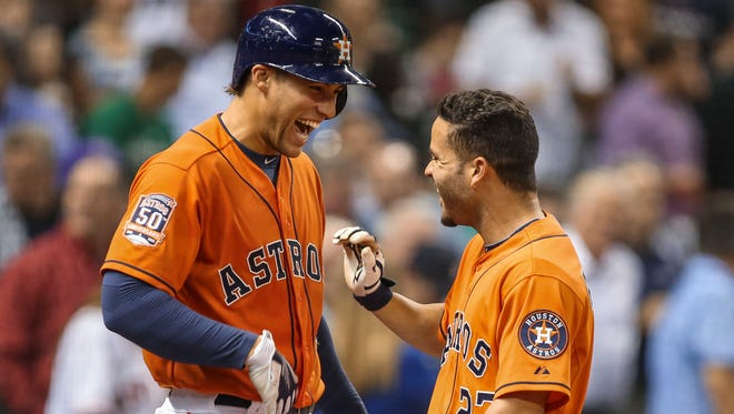 "Jose Altuve, right, signed an extension to remain in Houston in the midst of a 111-loss season. ""I knew we were going to get to this point,"" says Altuve, here with George Springer."