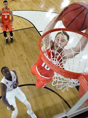 Syracuse guard Trevor Cooney (10) dunks against North Carolina.