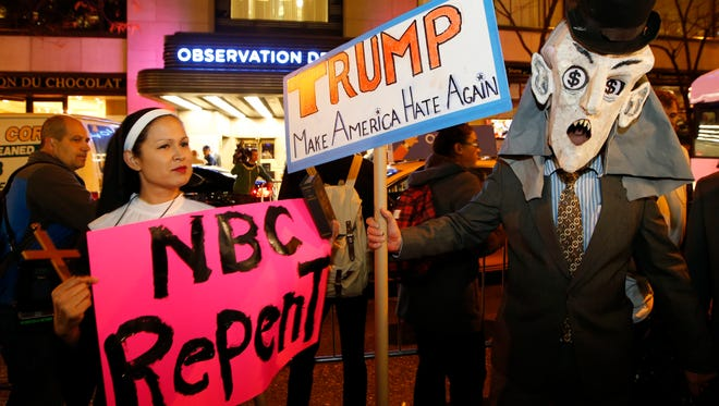 """Protesters opposed to the appearance of Republican presidential candidate Donald Trump as a guest host on this weekend's """"Saturday Night Live,"""" demonstrate in front of NBC Studios where the television show is taped and broadcast, Wednesday, Nov. 4, 2015, in New York."""