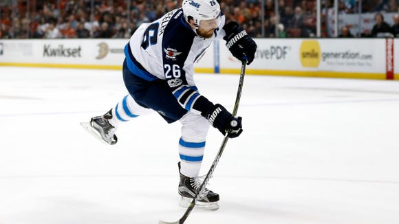 Winnipeg Jets right wing Blake Wheeler takes a shot during the first period of an NHL hockey game against the Anaheim Ducks, Friday, March 24, 2017, in Anaheim, Calif. (AP Photo/Ryan Kang)
