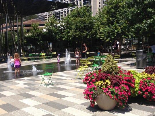 Kids play in a fountain in Klyde Warren Park in Dallas.