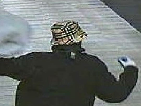 The suspect may have also had a black jacket, grey