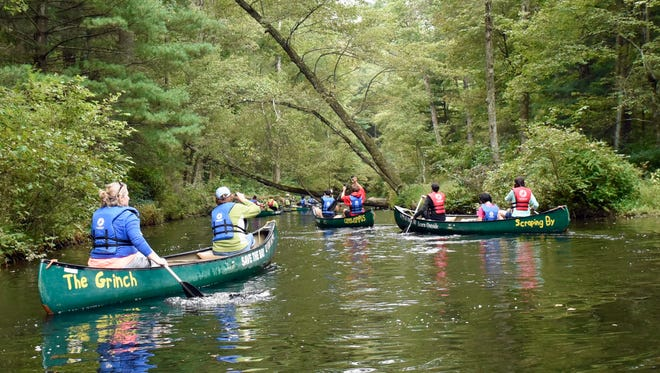Students from Chambersburg Career Magnet School paddle in canoes on Monday, Sept. 26, 2016 along Laurel lake. A group of AP students conducted a watershed exploration with members of Chesapeake Bay Foundation during the Susquehanna Watershed Education Program (SWEP).