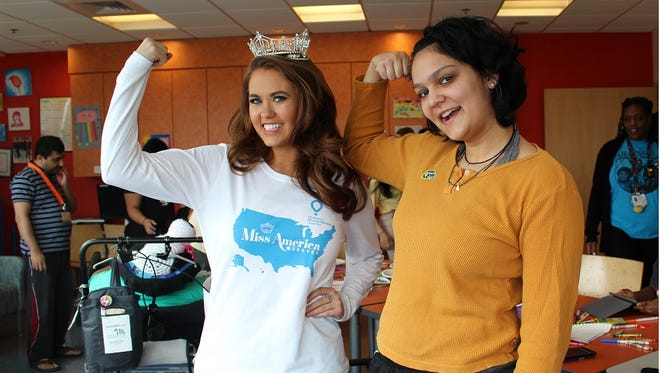 Miss America 2018, Cara Mund, and PSE&G Children's Specialized Hospital patient, Maya Bhallla-Ladd, flex some serious muscle to help raise awareness and funds benefiting Children's Miracle Network Hospitals on Miss America Serves Day.