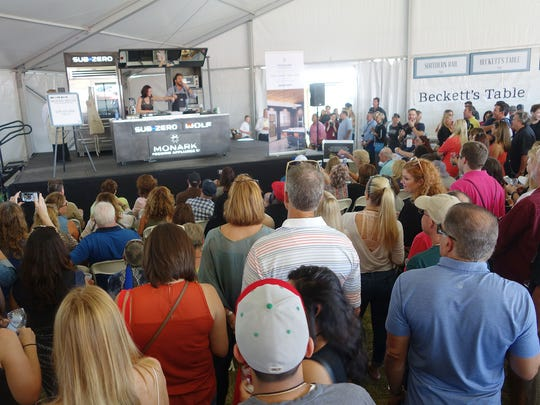 A crowd gathers to watch chef Scott Conant demo a ribeye