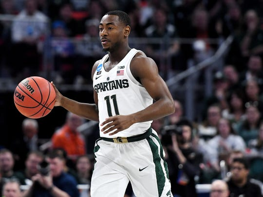 Michigan State's Lourawls Nairn Jr. moves with the