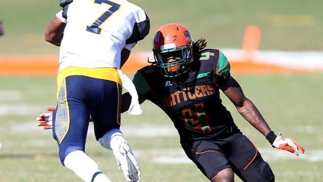 Terry Johnson (No.4) tackle tackles North Carolina A&T's Lewis Kindle last season at Bragg Stadium.