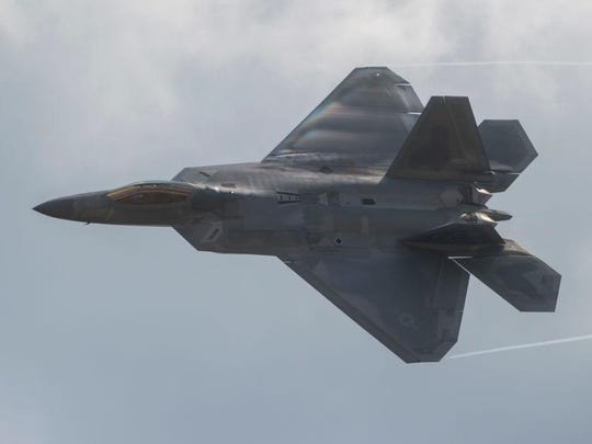 An F-22 Raptor does a fly-by at Joint Andrews Air Base in Maryland in this September 16, 2017 file photo. The North American Aerospace Defense Command says two F-22 and two CF-18 fighter jets identified two Russian Tu-160 Blackjack strategic bombers that were entering an area patrolled by the Royal Canadian Air Force on Saturday morning.