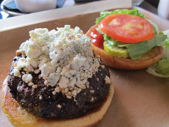 Jimmy's P's Burgers & More, which recently opened in North Naples, specializes in craft burgers, including this Cajun blue cheese burger, which includes a Cajun-spiced Wagyu patty with blue cheese crumbles.