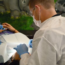 Dentist Cody Hughes works on a patient at Valley Pediatric Dental.