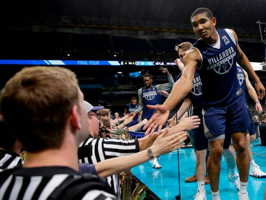 Villanova forward Jermaine Samuels, right, greets pep band member after a practice session for the Final Four NCAA college basketball tournament, Friday, March 30, 2018, in San Antonio. (AP Photo/Eric Gay)
