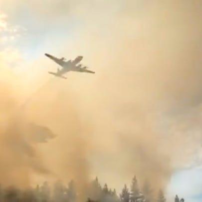 An air tanker flies over the Green Top Mountain Fire
