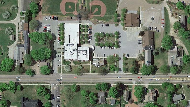 Aerial photo of Shelburne town center, looking west. Pierson Library is on the right of the parking area, behind and attached to the Historic Town Hall. One potential site would be closer to U.S. 7, which is shown in photo.