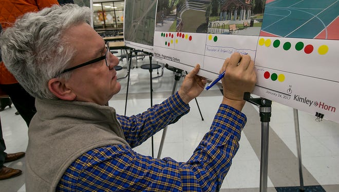 Jake Burkhalter writes a comment at the Murfreesboro Parks and Rec public input meeting for the park that will be built in the Blackman community.