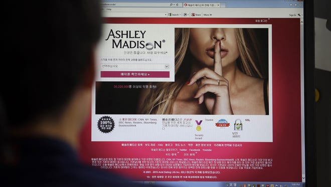 Ashley Madison's website is shown on a computer screen in Seoul, South Korea. The site, billed as a matchmaker for cheating spouses, was hacked by persons who leaked the data online Wednesday.
