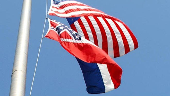 This is a file photo of flags on the Mississippi State University campus.