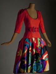 """""""Inspiring Beauty: 50 Years of Ebony Fashion Fair"""" at the University of Rochester's Memorial Art Gallery exhibits 40 show-stopping ensembles, like this Yves Saint Laurent """"Picasso"""" evening dress."""