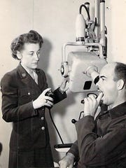 Esther Sara Silverman shown working as a dental assistant in the Army during World War II.