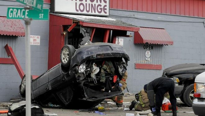 Rescue workers respond to a multi-vehicle crash at the doorstep of the Greystone Lounge. Several injuries are reported.