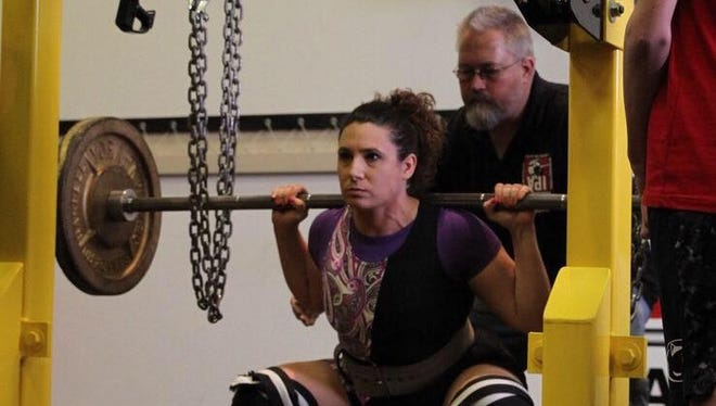Palmyra's Jess Maloy competes in an International Powerlifting Association meet at York Barbell on March 5.