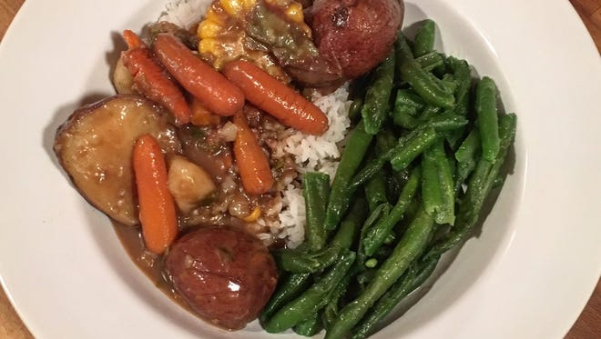 Rich gravy with hearty vegetables makes for a satisfying meal even without meat