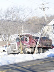The dump truck involved in the crash had front-end damage on the driver's side