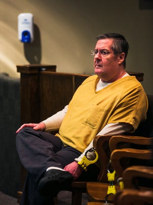 April 27, 2017 - Shelby County businessman Mark Giannini sits handcuffed to a chair in Judge Mark Ward's courtroom to await talk about his bond at the Shelby County Criminal Justice Center on Thursday morning.