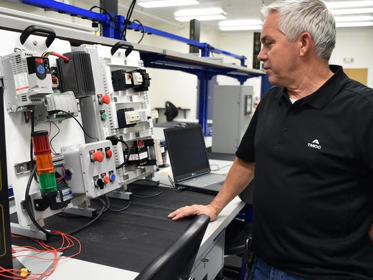 Production technology instructor Randal Walden stands next to an industrial control panel typically found in manufacturing facilities. It is used to teaching industrial wiring and programmable logic control at the Applied Industrial Technologies Center of TMCC to train people who want to work at the Tesla Gigafactory and other advanced manufacturing operations.