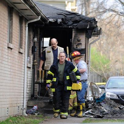 The Nashville Fire Department investigates a house
