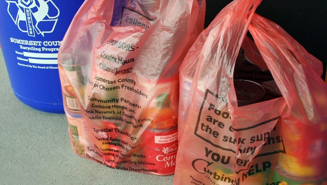 Orange bags of donated canned goods.