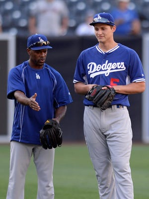 Jimmy Rollins speaks with Corey Seager before a Dodgers game against the San Diego Padres at Petco Park.