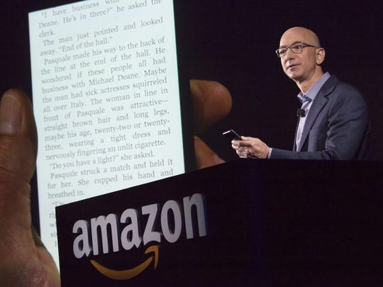 Amazon.com founder and CEO Jeff Bezos demonstrates the company's first smartphone, the Fire Phone, on June 18, 2014 in Seattle, Washington. (Photo by David Ryder/Getty Images)