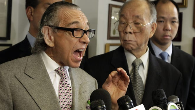 Attorney Sanford Rubenstein, left, during a news conference in New York earlier this year. Rubenstein is accused of sexually assaulting a woman after attending a birthday party for the Rev. Al Sharpton on Wednesday. (AP Photo/Richard Drew)
